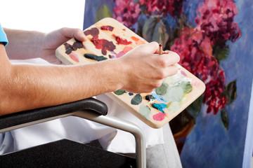 Painter in a wheelchair