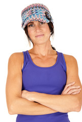 beautiful brunette wearing knit hat and tank top with arms folde