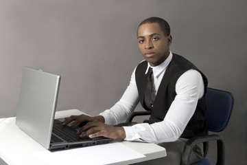 Black Man at office behind  desk