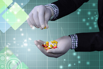 Different pills on the hand of doctor