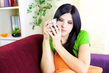 Woman enjoying coffee at home