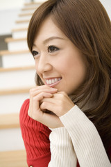 woman sitting on stairs smiles