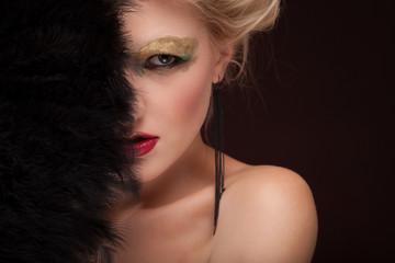 elegant Beautiful blonde lady with black feather fan.