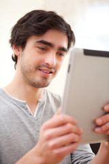 Young man using a tablet at the office
