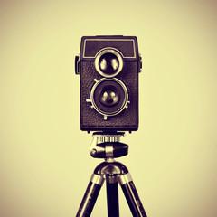 old camera in a tripod