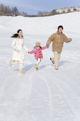 family running snowy field