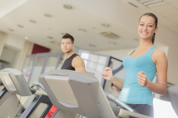 Young man and woman training in the gym