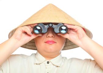 Asian traveler exploring looking through binoculars .