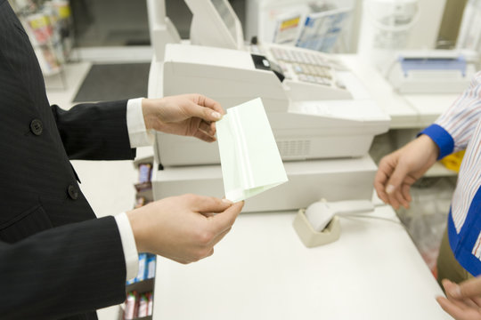 woman receiving ticket at convenience store