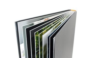 Black photo album isolated on white