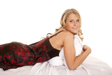 Woman black and red nightgown lay on stomach look