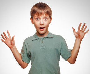 teenager kids boy raised his hands up surprised