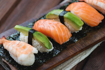 Sushi with salmon, shrimp and avocado, close-up