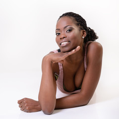 Beautiful young african woman smiling and looking at camera, ove