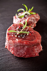 Fresh beef raw steaks on black stone