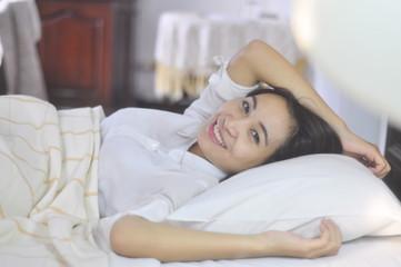 beautiful girl sleeps in the white bedroom