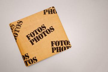 Photo Album with burlap texture on table