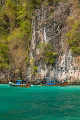 Longtail boats in the famous Maya bay of Phi-phi Leh island