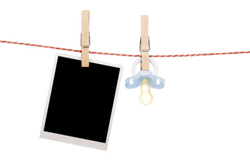 Instant photo and pacifier hanging on the clothesline