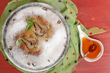 Wall Mural - Pear pie with honey on red wooden table