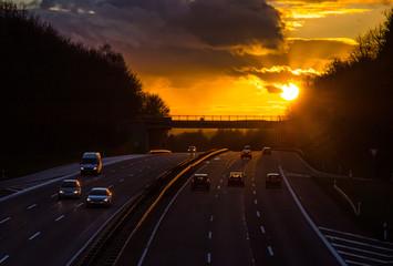 Wall Mural - Sonnenuntergang auf Autobahn dreispurig Deutschland
