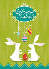 Easter card with two white bunnies and painted eggs.