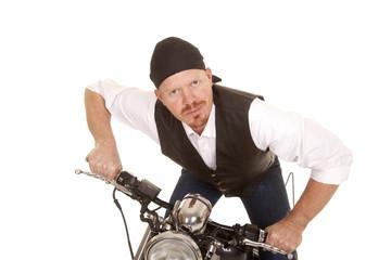 Man bandana motorcycle lean forward slight smile