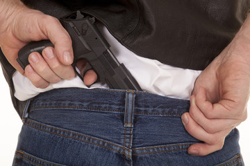 Pull gun out of pants
