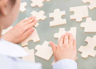Businesswoman With Scattered Puzzle