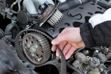 Service, car mechanic replace timing belt at camshaft of engine Fotomurales