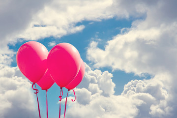 Red balloons on blue sky