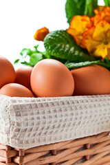 basket with spring flowers and eggs
