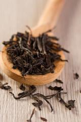 Spoon of dried tea leaves