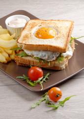 Fresh triple decker premium club sandwich with french fries