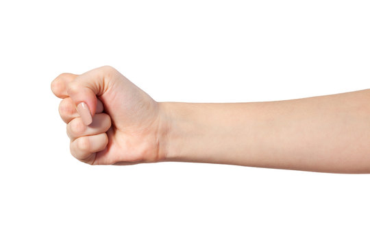 Female hand with a clenched fist isolated
