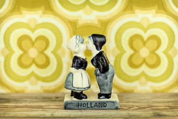 Retro styled image of a Dutch souvenir with kissing boy and girl