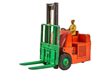 Vintage toy fork lift truck isolated on white