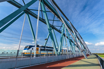 Dutch train passing a bridge in Nijmegen