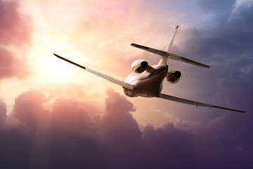 Fotobehang - Private Jet PLane in the sky at sunset