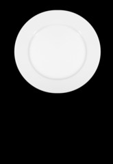 perfect white plate isolated on black background