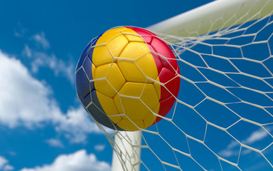 Romania flag and soccer ball in goal net