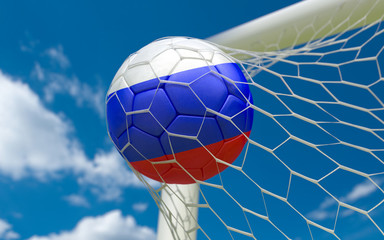 Russia flag and soccer ball in goal net