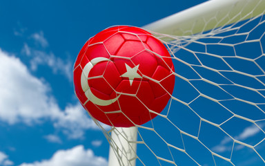 Turkey flag and soccer ball in goal net