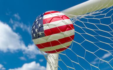 USA flag and soccer ball in goal net