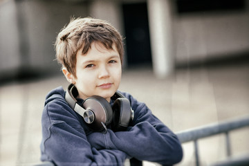 Young boy with headphones in grunge look