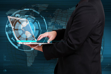 Wall Mural - Businessman holding a laptop with globe and icon application on