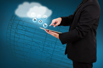 Wall Mural - Businessman holding tablet show cloud computing concept on virtu