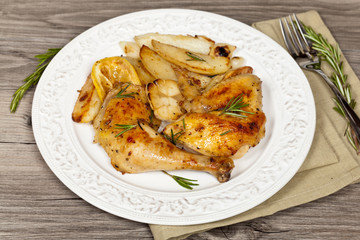 Chicken with Garlic, and Rosemary with potato. Selective focus.