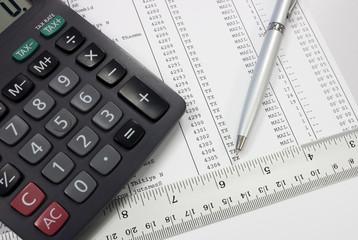 calculator pen ruler on document