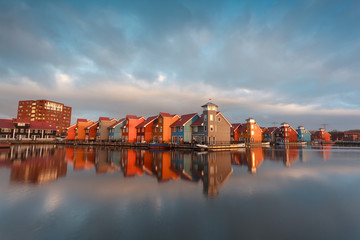 Fototapete - colorful buildings on water in morning sunlight
